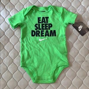 Green Nike baby onesie